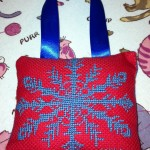 Blue-Snowflake-Cross-Stitched-on-Red-by-Angela