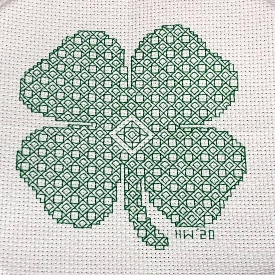blackwork four leaf clover stitched by H. Weaver