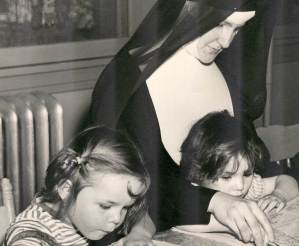Sister with children who are coloring