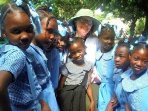 Sister Lynn Miller with Haitian school girls.