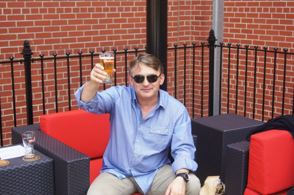 The president of Bosnia and Herzegovina, Zeljko Komsic, enjoys a Budweiser at The Biergarten while visiting the Anheuser-Busch brewery in St. Louis