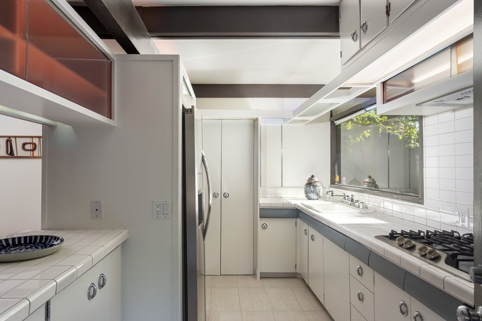 another-look-at-the-kitchen-a-small-passthrough-connects-to-the-living-room