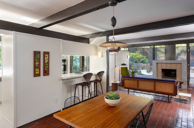 the-foyer-opens-up-into-the-dining-and-living-area-painted-beams-and-trim-highlight-the-structures-post-and-beam-design