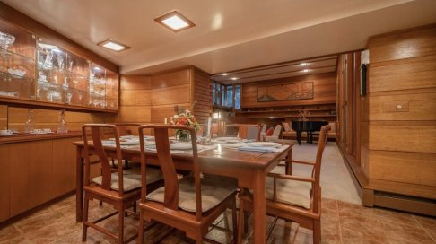 the-living-room-also-flows-into-a-formal-dining-area-which-features-additional-built-in-cabinetry-along-one-wall