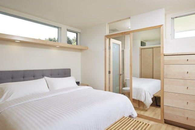 a-frosted-glass-door-in-the-bedroom-accesses-an-en-suite-bathroom