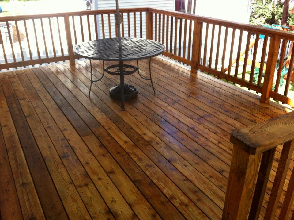carter custom painting power washes decks