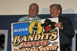 David Earl Gentry of Murfreesboro, TN receives the $2,500 Bilstein Bandits Championship Award from Jim Hiland of Bilstein Shocks. Gentry finished second in the 2012 NeSmith Chevrolet Dirt Late Model Series Touring Division point standings with three wins riding on the $135 Bilstein Spec Shocks. (Photo By Larry Sams)