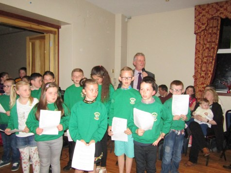 Our pupils from P1 right through to P7 worked hard in preparation for the evening & we are extremely proud of their performances on the night. They re-told stories about their memories of Fr Kerr, recited poems they penned especially for him, played guitar, performed Irish Dancing and sang 'The Road to Clady' and 'The Boys from County Armagh'.