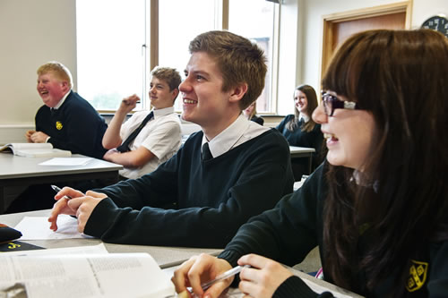 Pupils laughing in classroom