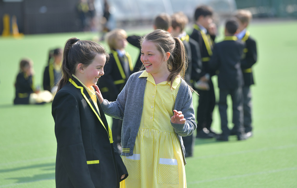 Junior School pupils smiling outside