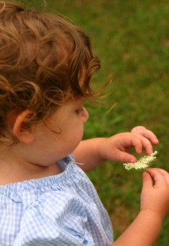 Young Child with Flower