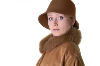 Isolated Woman in Brown Hat and Cote