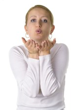 Isolated Woman Blowing a Kiss