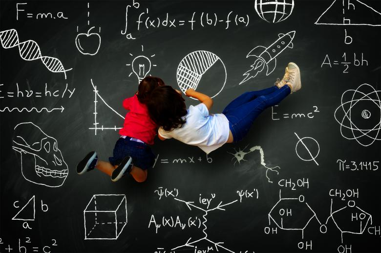 Free Stock Photo of Two little girls writing on a blackboard with science subjects Created by Jack Moreh