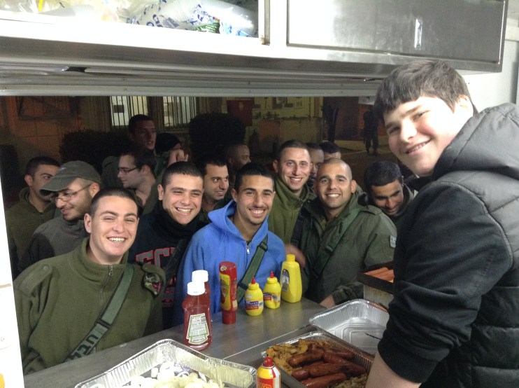 IDF troops start lining up for Ben's specialty BBQ! Can you tell they're happy?