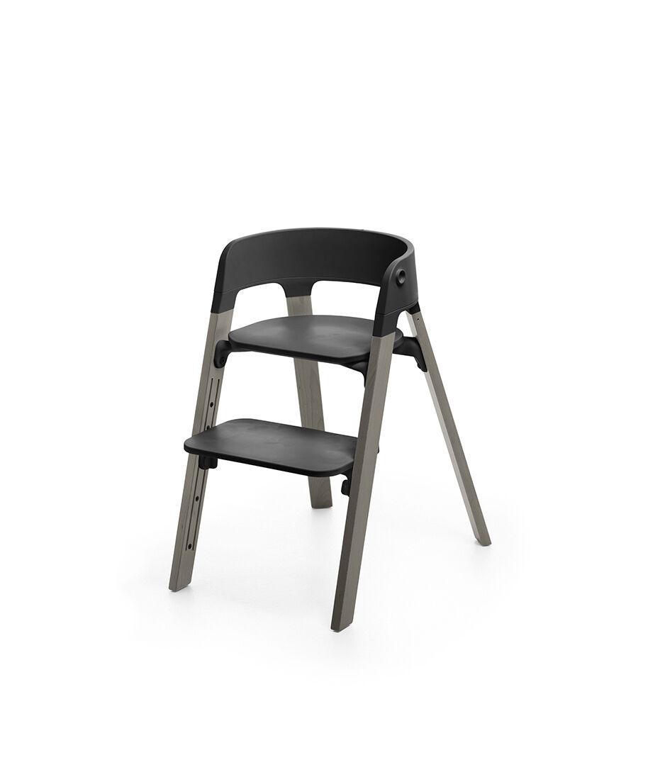 stokke high chair tray bentwood office steps black seat hazy grey legs