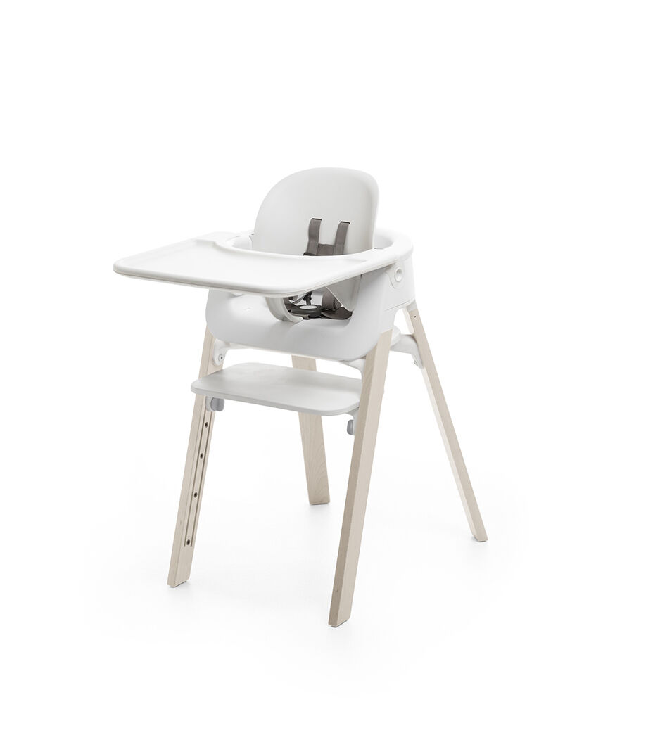 stokke high chair tall drafting table steps baby set tray white mounted on highchair