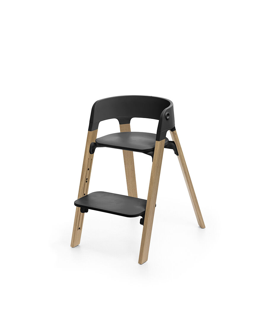 first step high chair heavy duty camping stokke steps black seat oak natural legs