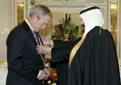 Oh NOES!!!! (ok you get it) President Bush bows while getting pimped out in Islamic bling!