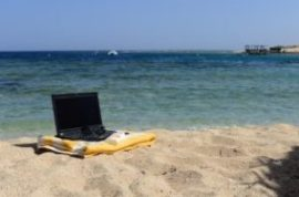 laptop near beach