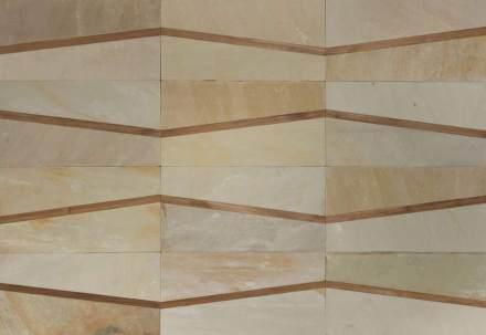 Das Material sind helle oder dunkle Schiefersorten. Dazu kommen schmale Leisten aus Holz, Stahl, Glas oder Leder.