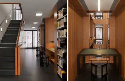 """The stone photos on the glass front are not mere décor. They serve the function of filtering the sun's rays which floods the library with """"soft, warm light"""", as the architect describes."""