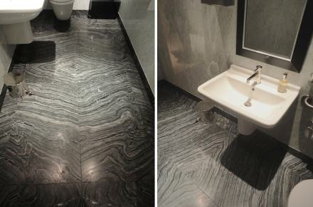 In the restrooms natural stone provides an air of opulence: the walls are clad in Carrara marble and the flooring is made of book-matched Wave marble.