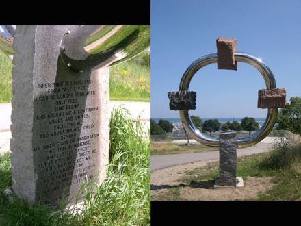 "Jon Barlow Hudson: ""Compass"". Looking east, 12' h. x 10' w. x 3' d., includes poem by Jean Barlow Hudson. 4 Wisconsin granites: Wausau Ruby Red, Glacial Rose, Amberg Silver Grey & Mellen Black Gabbro."