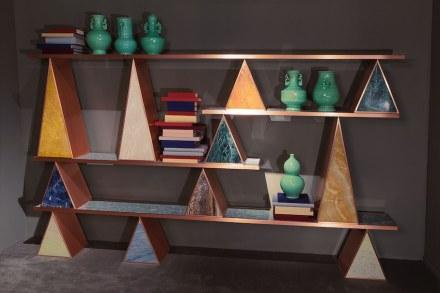 "Citco-Privé: ""Giza"". Product: bookshelf. Measures: 300x172hx32d cm. Material: polychrome marbles, satin copper outlines."