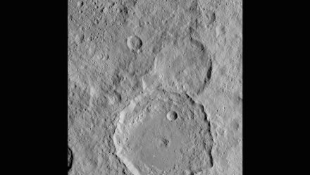 Image of Gaue crater, the large crater on the bottom, on Ceres. Gaue is a Germanic goddess to whom offerings are made in harvesting rye.