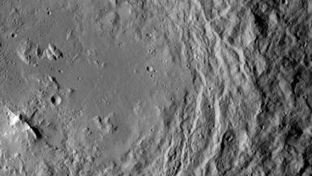 A mountain ridge, near lower left, that lies in the center of Urvara crater on Ceres.