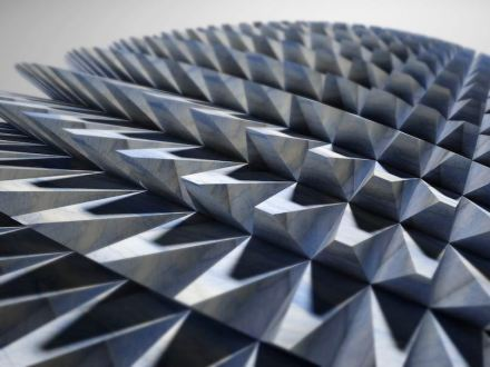 """Digital Lithic Design: """"Acus"""". This is a kind of armour sprinkled with pointed, slanted elements. Processing this item was made possible thanks to diamond disc cuts on a five‐axis milling machine following precise 3D machining paths. The particular delicacy of the tips is preserved by the precision of the device that cuts and polishes the surfaces simultaneously to avoid the need for subsequent finishing operations. Design: Raffaello Galiotto, produced by Gmm."""