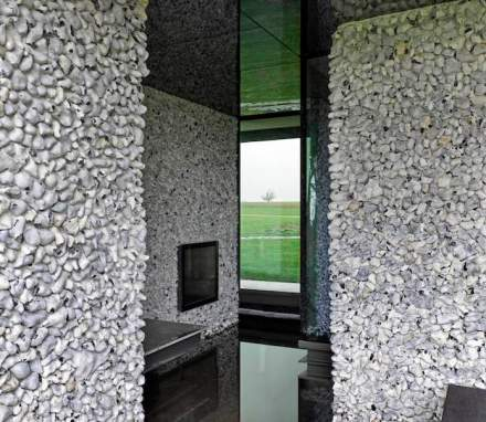 Some of the walls incorporate chunks of flint stone, imbedded in the mortar; the furniture was designed to fit into the ambiance.