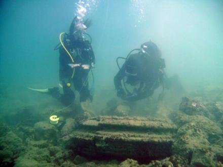 Divers scrutinizing remains of an alleged long lost Greek city at the island of Zakynthos which turned out to be created by a naturally occurring phenomenon.