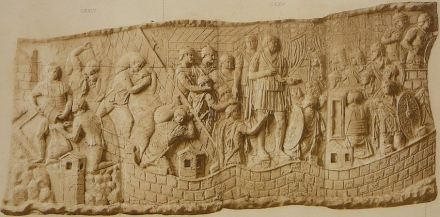 War against the Dakers: looting (left), Trajan gives a speech (center), troops marching (right).