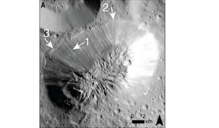 Dawn's Framing Camera looks down on the fractured summit of Ahuna Mons, tallest mountain on dwarf planet Ceres. The cracks on top suggest Ahuna grew by inflation: icy freezing water pushed up inside the mountain, making a dome. Source: Science