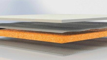 Fiberglass backing bonds the natural stone and cork layers.