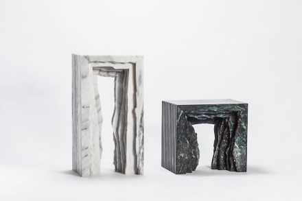 """Split Marble Collection"": is inspired from the sawing process of the marble. Being cut artificially, the retaining rough rims of stone pieces greatly contrast the smooth profile. Through stacking, the common way to place the slabs, the rough edges create the image of a layered cavern beneath the table and the stool. The stiff outlines together with the irregular fractures present the aesthetic of dissonance. Designer: Chang Chia-Ling; manufacturer: Shinying Enterprise Co., Ltd.; material: Serpentinite, Taiwanese white marble."