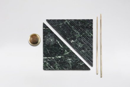 """""""Shih-Shih"""": Taking advantage of marble's quality of cooling down temperature to keep raw food fresh, Shih-Shih uses the material as a raw food tray. It is consisted of trays, chopsticks and a saucer. When all the components are combined, is as a whole becomes a square. The jigsaw-shaped tray not only makes food breathable and less likely perishable, but is also more compatible with chopsticks. Designer: Wu Chen-Yi; manufacturer: Chia-Tai Marble Co., Ltd. / Stone and Resource Industry R&D Center; material: Serpentinite, brass."""