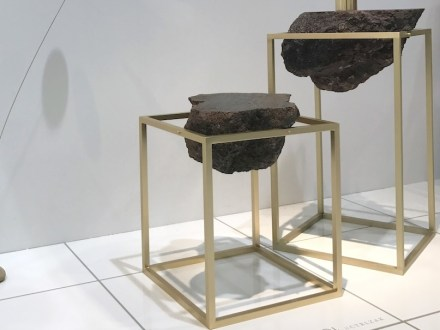 """""""Antivol"""" is a side table made of lava blocks braced in a simple metal frame."""