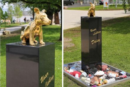 """Michael Gruber, """"Human Dignity"""". The lap dog reflects the Biblical Dance around the Golden Calf. At the foot of the stele: refuse with chards of urns. The Catholic Church allows cremation since 1963."""