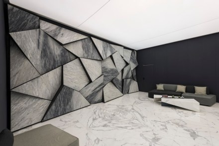 "Best Communicator Award, Stone, Italy: First Prize to Errebi Marmi ""for the astonishing grace of the marble surfaces protruding from the wall to enhance the chromatic characteristics of the material. Light and furnishing were chosen and designed to emphasize the identity of the project"". Photo: Luca Morandini"