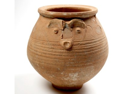 Face pot used as a cremation urn.