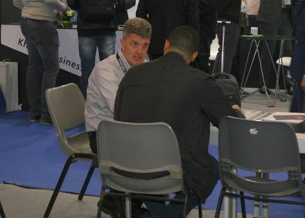 Jim Hieb, giving valuable information to a member of the NSI, at a fair in more quite times.