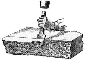 Block of stone being carved by a chisle