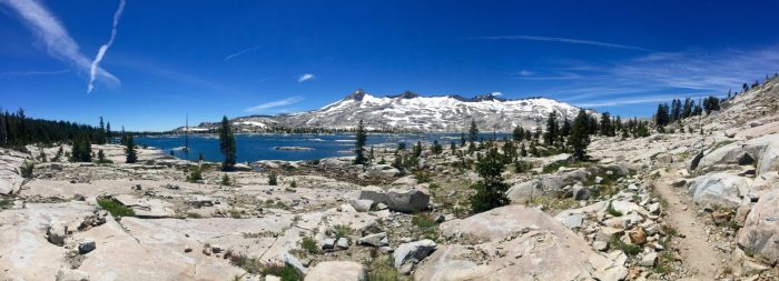 Aloha Lake in a Sierra like setting with snowy mountains rising beyond