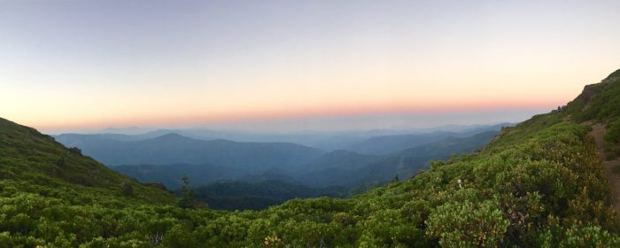 Distant waves of mountain ranges at sunrise