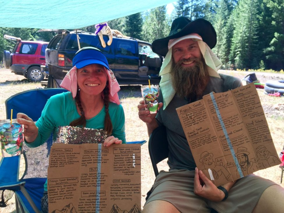 Beardoh and Sweet Pea posing with menus at Le Bistro trail magic