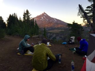 Sitting at a camp with a front row seat for sunset on Mt. Jefferson