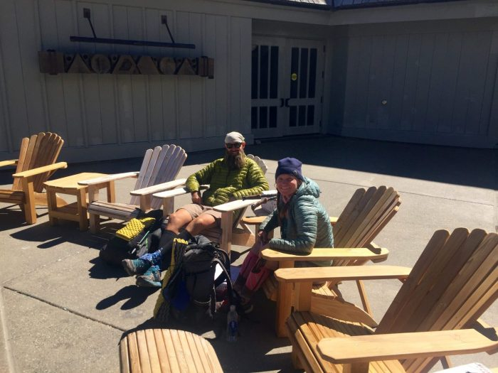 Beardoh and Sweet Pea lounging on the patio of Timberline Lodge